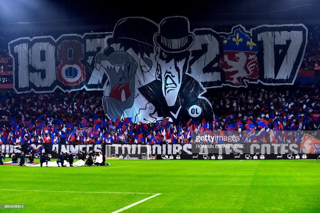 Lyon's fans hold a banner reading 1987-2017 as they celebrate the 30 years anniversary of the supporters club 'Bad Gones' during the French L1 football match between Lyon (OL) and Marseille (OM) on December 17, 2017, at the Groupama stadium in Decines-Charpieu near Lyon, central-eastern France. /