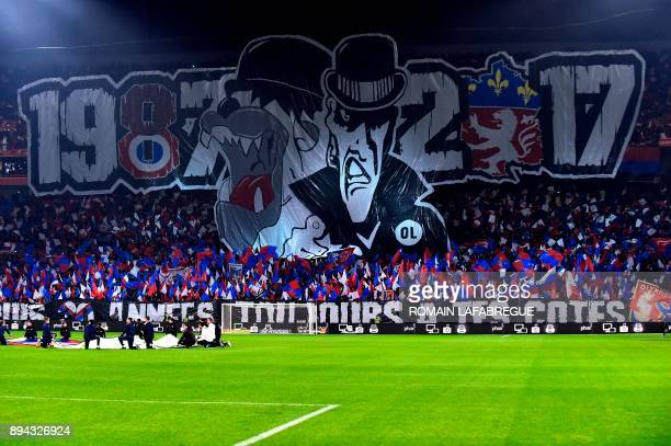 Lyon's fans hold a banner reading 19872017 as they celebrate the 30 years anniversary of the supporters club Bad Gones during the French L1 football...