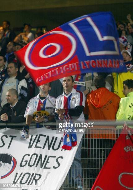 Lyon's fans jubilate at the end of the French L1 soccer match MontpellierLyon 20 may 2003 at the La Mosson stadium in Montpellier The match ended in...
