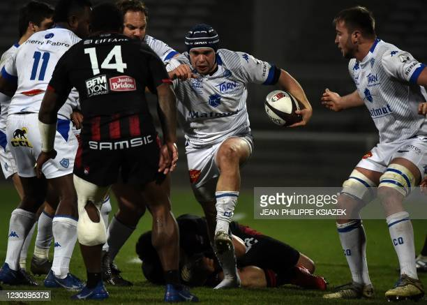 Lyon's Fijian wing Josua Tuisova fights for the ball with Castres' French hooker Gaetan Barlot during the French Top 14 rugby union match between...