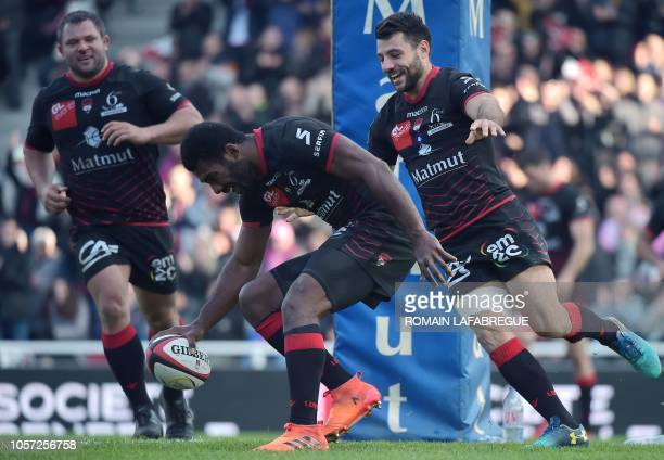 Lyon's Fijian winger Noa Nakaitaci scores a try during the French Top 14 rugby union match between Lyon and Stade Francais on November 4 2018 at the...
