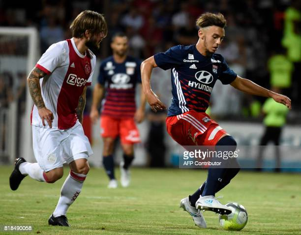 Lyon's forward Amine Gouiri holds off Ajax forward Lasse Schone during a friendly football match between Olympique Lyonnais and Ajax Amsterdam on...