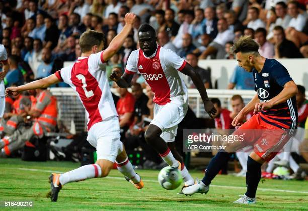 Lyon's forward Amine Gouiri kicks despite Ajax defender Joel Veltman during a friendly football match between Olympique Lyonnais and Ajax Amsterdam...