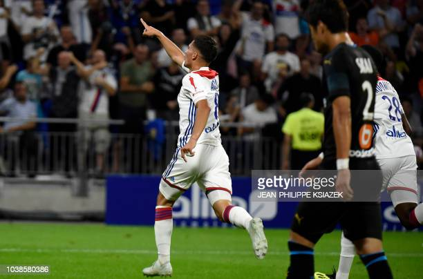 Lyon's forward Houssem Aouar celebrates after scoring a goal a goal during the French L1 football match between Lyon and Marseille on September 23...