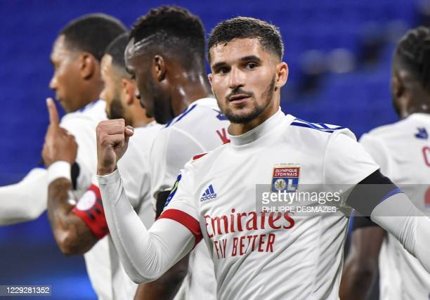Lyon's forward Houssem Aouar celebrates after scoring a goal from the penaltykick during the French L1 football match between Olympique Lyonnais and...