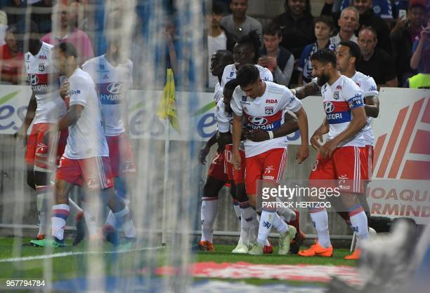 Lyon's forward Houssem Aouar is congratulated by teammates after scoring a goal during the French L1 football match between Strasbourg and Lyon on...