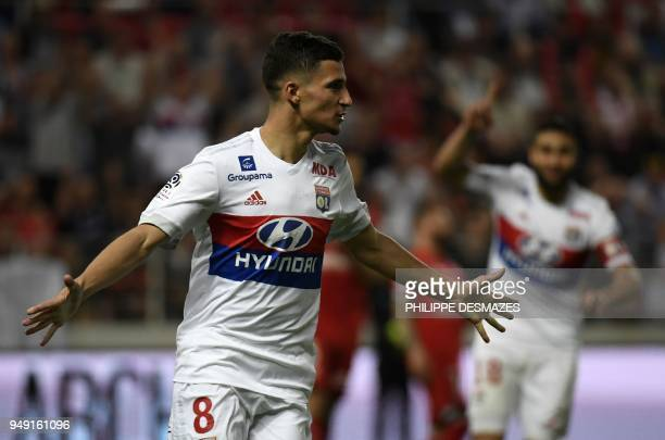 Lyon's forward Houssem Aouar reacts after scoring during the French L1 football match between Dijon FCO and Olympique Lyonnais on April 20 at the...