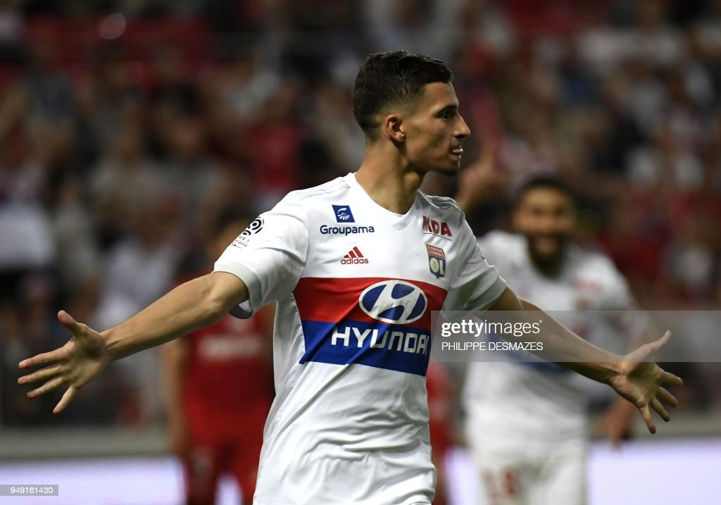 Lyon's forward Houssem Aouar reacts after scoring during the French L1 football match between Dijon FCO and Olympique Lyonnais, on April 20, 2018, at the Gaston Gérard Stadium in Dijon, central France.