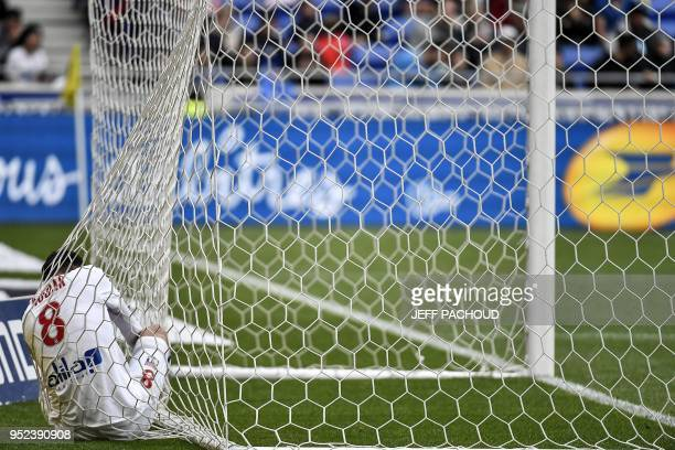 TOPSHOT Lyon's forward Houssem Aouar reacts during the French L1 football match Olympique Lyonnais vs FC Nantes on April 28 at the Parc Olympique...