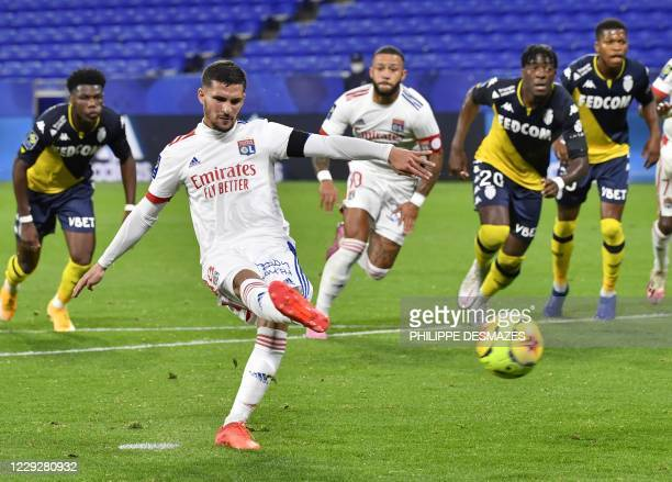 Lyon's forward Houssem Aouar scores a goal from the penaltykick during the French L1 football match between Olympique Lyonnais and AS Monaco at the...