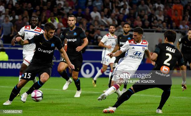 Lyon's forward Houssem Aouar shoots and scores a goal during the French L1 football match between Lyon and Marseille on September 23 2018 at the...