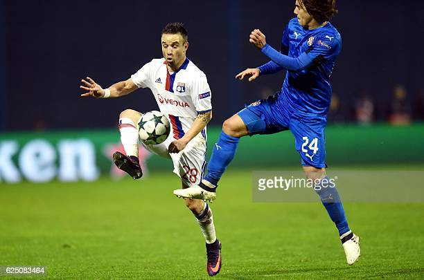 Lyon's forward Mathieu Valbuena vies with Dinamo's midfielder Ante Coric during the UEFA Champions League Group H football match between GNK Dinamo...