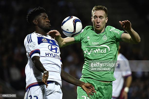 Lyon's French Cameroonian defender Samuel Umtiti challenges SaintEtienne's Slovenian foward Robert Beric during the French L1 football match between...