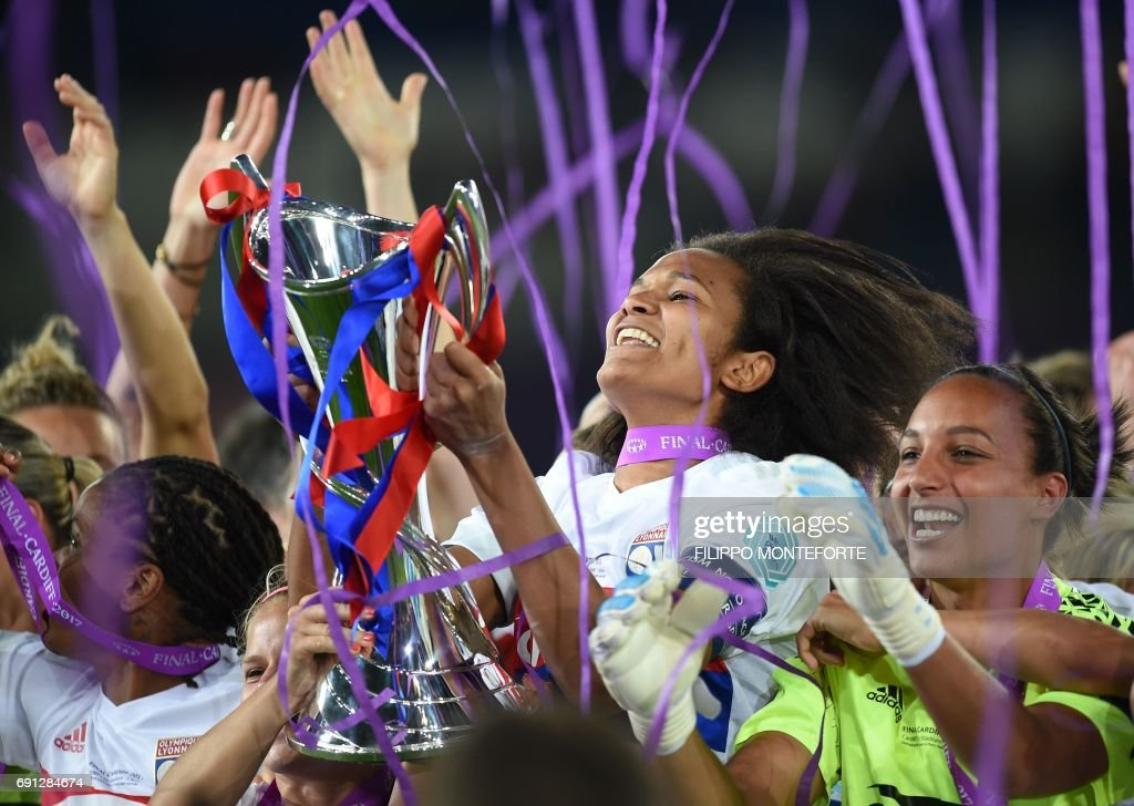 Lyon's French captain Wendie Renard holds the Women's Champion's League trophy as she celebrates victory after the UEFA Women's Champions League final football match between Lyon and Paris Saint-Germain at the Cardiff City Stadium in Cardiff, south Wales, on June 1, 2017. /