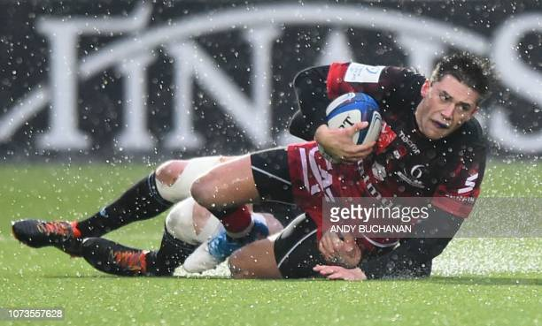 Lyon's French centre PierreLouis Barassi is tackled during the European Champions Cup rugby union pool match between Glasgow Warriors and Lyon at...