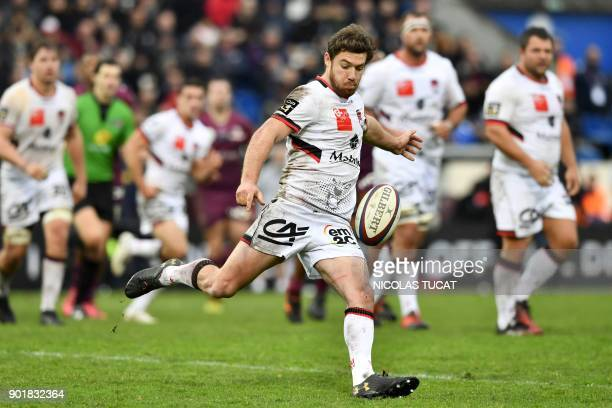 Lyon's French centre Theo Belan kicks the ball during the French Top 14 rugby union match between Bordeaux-Begles and Lyon on January 6, 2018 at the...