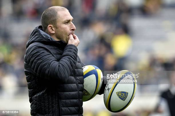 Lyon's French coach Pierre Mignoni whistles as he reacts during the French rugby union match between ASM Clermont and LOU Lyon at the Michelin...