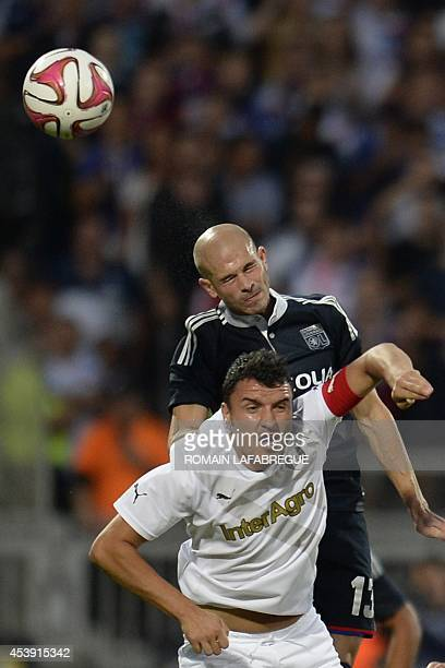 Lyon's French defender Christophe Jallet vies for the ball with Giurgiu's Romanian midfielder Constantin Valentin Budescu during the UEFA Europa...