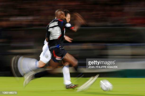 Lyon's French defender Eric Abidal vies with Kiev's Croatian defender Goran Sabljic during their Champion's league football match 01 november 2006 at...