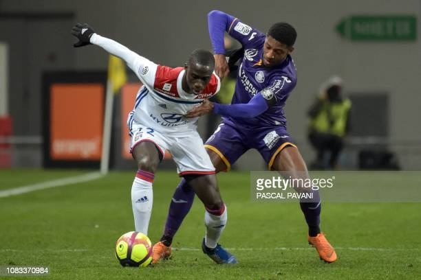 Lyon's French defender Ferland Mendy fights for the ball with Toulouse's French defender Steven Moreira during the French L1 football match between...