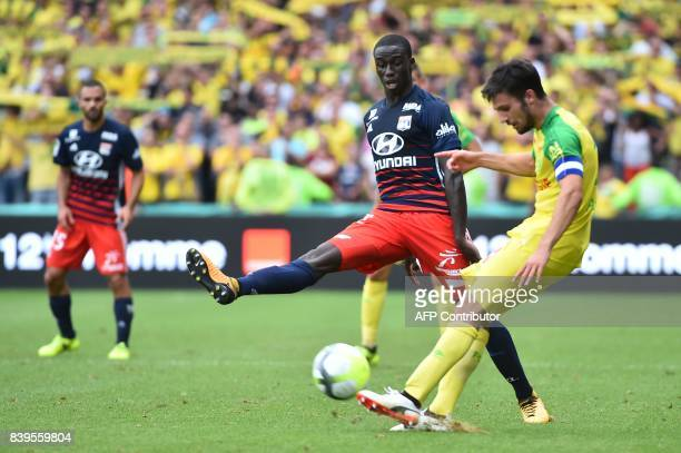 Lyon's French defender Ferland Mendy vies for the ball with Nantes' French defender Leo Dubois during the French L1 football match between Nantes and...
