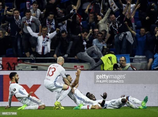 Lyon's French defender Jeremy Morel reacts next to Lyon's French defender Christophe Jallet Lyon's French midfielder Nabil Fekir and Lyon's French...