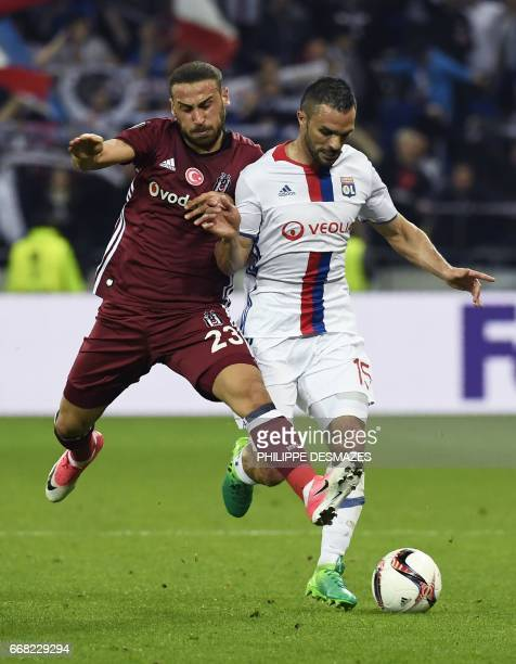 Lyon's French defender Jeremy Morel vies with Besiktas' Turkish forward Cenk Tosun during the UEFA Europa League first leg quarter final football...