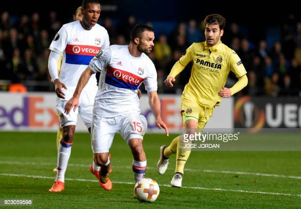 Lyon's French defender Jeremy Morel vies with Villarreal's Spanish midfielder Manuel Trigueros Munoz during the Europa League Round of 32 second leg...