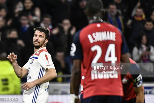 Lyon's French defender Leo Dubois celebrates after scoring a goal during the French L1 football match between Olympique Lyonnais and Lille on May 5...