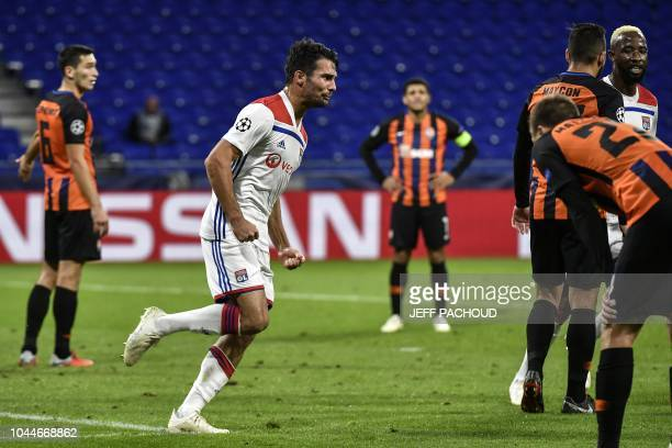 Lyon's French defender Leo Dubois celebrates after scoring during their UEFA Champions League Group F football match Olympique Lyonnais vs FC...
