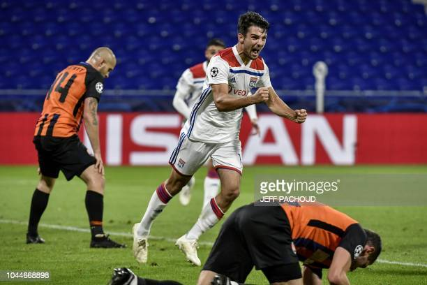 Lyon's French defender Leo Dubois celebrates after scoring their second goal during their UEFA Champions League Group F football match Olympique...