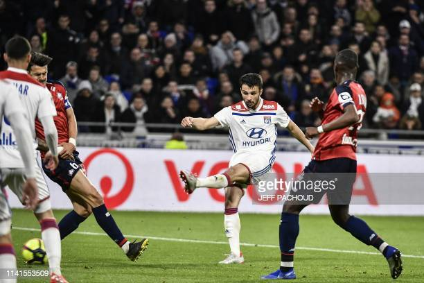 Lyon's French defender Leo Dubois scores a goal during the French L1 football match between Olympique Lyonnais and Lille on May 5 at the Parc...