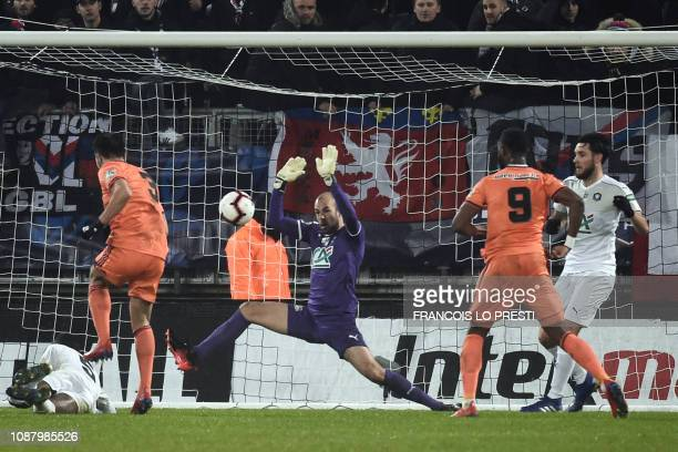 Lyon's French defender Leo Dubois scores a goal past Amiens' French goalkeeper Matthieu Dreyer during the French Cup round of 16e football match...