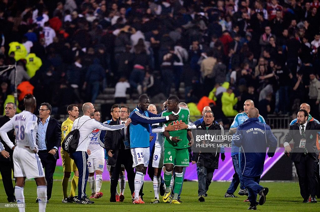Lyon's French defender Mouhamadou Sarr (C-left) and St Etienne's French defender Kurt Zouma (C-right) scuffle during the French L1 football match Olympique Lyonnais (OL) vs Saint-Etienne (ASSE) at the Gerland stadium in Lyon, southeastern France, on March 30, 2014.