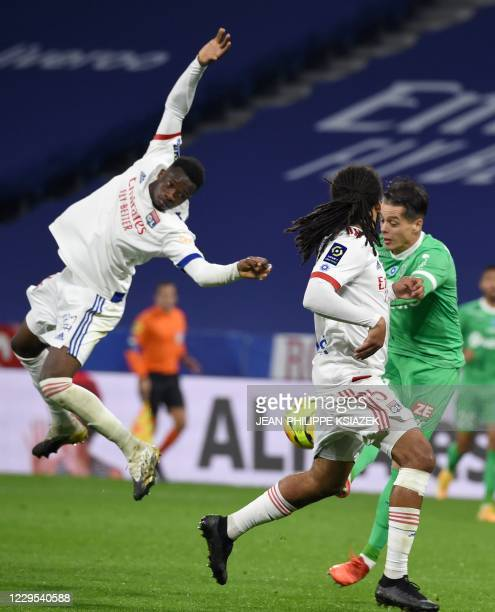 Lyon's French defender Sinaly Diomande fights for the ball withSaintEtienne's French forward Romain Hamouma during the French L1 football match...