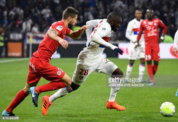 Lyon's French defender Tanguy Ndombele outruns Montpellier's French midfielder Paul Lasne during the French L1 football match Lyon vs Montpellier on...