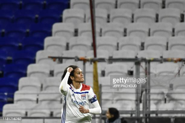 Lyon's French defender Wendie Renard celebrates after scoring a goal during the UEFA women's Champions League quarterfinal football match between...