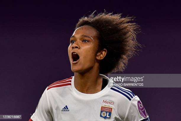 Lyon's French defender Wendie Renard celebrates after scoring a goal during the UEFA Women's Champions League semi-final football match between Paris...