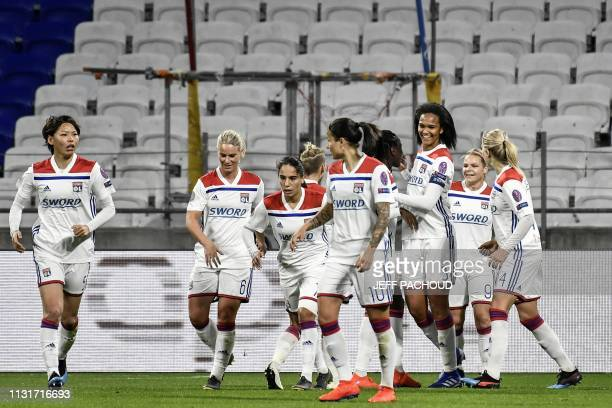 Lyon's French defender Wendie Renard celebrates with team mates after scoring a goal during the UEFA women's Champions League quarterfinal football...