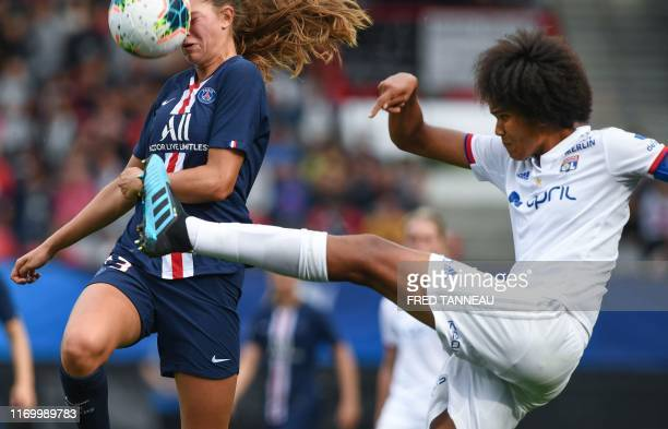 Lyon's French defender Wendie Renard fights for the ball with Paris SaintGermain's Canadian forward Jordyn Huitema during the Trophee des Championnes...