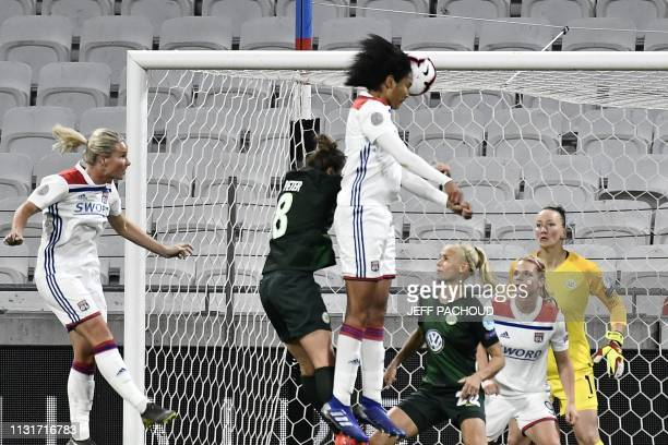 Lyon's French defender Wendie Renard jumps for the ball and scores a goal during the UEFA women's Champions League quarterfinal football match...