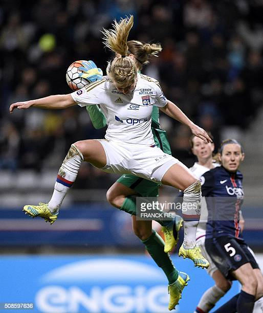 Lyon's French forward Ada Hegerberg and Paris SaintGermain's German goalkeeper AnnKatrin Berger jump for the ball during the French Women's D1...