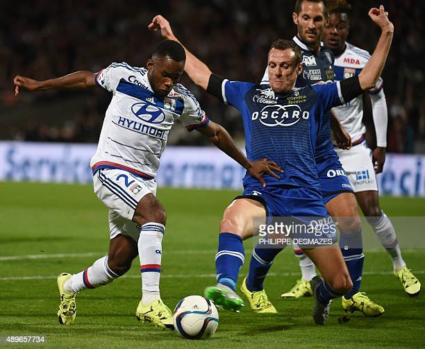 Lyon's French forward Aldo Kalulu vies with Bastia's French defender Sebastien Squillaci during the French L1 football match between Olympique...