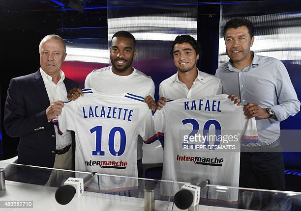 Lyon's French forward Alexandre Lacazette and newly player Brazilian defender Rafael da Silva pose with their jersey flanked by Lyon's French coach...