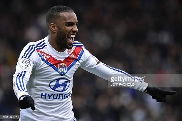 Lyon's French forward Alexandre Lacazette celebrates after scoring a goal during the French L1 football match Olympique Lyonnais vs Evian Thonon...