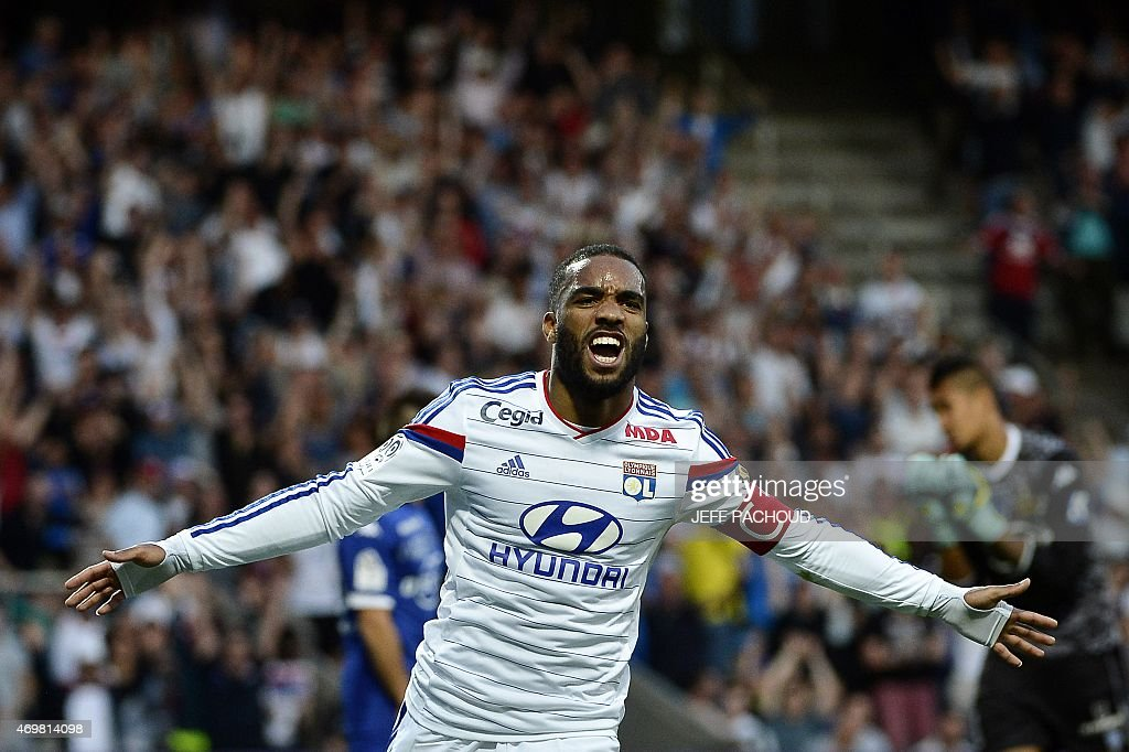 Lyon's French forward Alexandre Lacazette celebrates after scoring a goal during the French L1 football match Olympique Lyonnais (OL) vs SC Bastia (SCB) on April 15, 2015, at the Gerland Stadium in Lyon, central-eastern France.