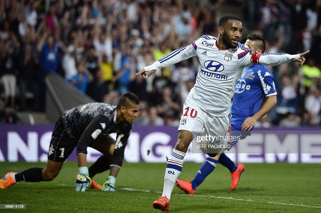Lyon's French forward Alexandre Lacazette (R) celebrates after scoring a goal during the French L1 football match Olympique Lyonnais (OL) vs SC Bastia (SCB) on April 15, 2015, at the Gerland Stadium in Lyon, central-eastern France.
