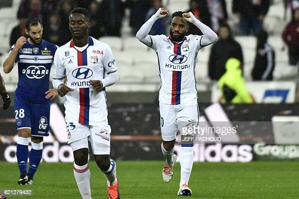 Lyon's French forward Alexandre Lacazette celebrates after scoring a goal during the French L1 football match Olympique Lyonnais vs Bastia on...