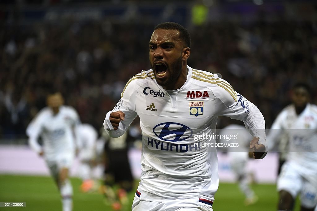 Lyon's French forward Alexandre Lacazette celebrates after scoring during the French L1 football match Olympique Lyonnais and OGC Nice on April 15, 2016, at the New Stadium in Decines-Charpieu near Lyon, southeastern France.