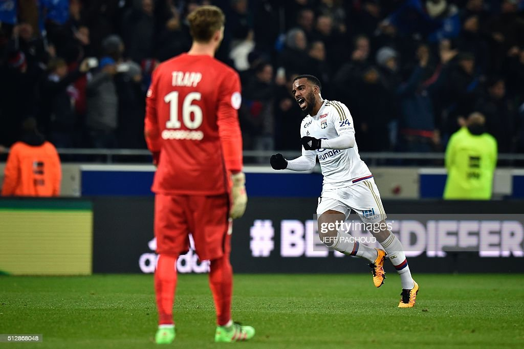 Lyon's French forward Alexandre Lacazette celebrates at the end of the French L1 football match Olympique Lyonnais (OL) vs Paris Saint-Germain (PSG) on February 28, 2016, at the New Stadium in Decines-Charpieu, central-eastern France.